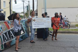Holding their winning check at the Central City Fest